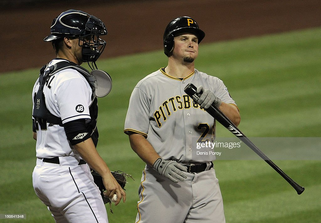 <a gi-track='captionPersonalityLinkClicked' href=/galleries/search?phrase=Travis+Snider&family=editorial&specificpeople=4959427 ng-click='$event.stopPropagation()'>Travis Snider</a> #23 of the Pittsburgh Pirates flips his bat after striking out during the third inning of a baseball game as Yasmani Grandal #12 of the San Diego Padres looks on at Petco Park on August 20, 2012 in San Diego, California.