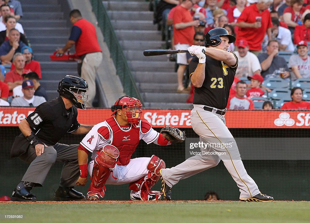 <a gi-track='captionPersonalityLinkClicked' href=/galleries/search?phrase=Travis+Snider&family=editorial&specificpeople=4959427 ng-click='$event.stopPropagation()'>Travis Snider</a> #23 of the Pittsburgh Pirates hits a single to right field in the second inning during the MLB game against the Los Angeles Angels of Anaheim at Angel Stadium of Anaheim on June 21, 2013 in Anaheim, California. The Pirates defeated the Angels 5-2.