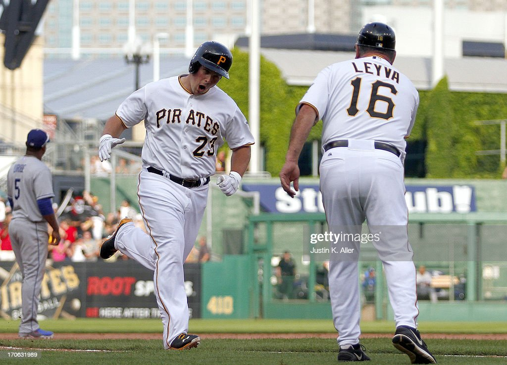 <a gi-track='captionPersonalityLinkClicked' href=/galleries/search?phrase=Travis+Snider&family=editorial&specificpeople=4959427 ng-click='$event.stopPropagation()'>Travis Snider</a> #23 of the Pittsburgh Pirates rounds third after hitting a game tying home run in the ninth inning against the Los Angeles Dodgers during the game on June 15, 2013 at PNC Park in Pittsburgh, Pennsylvania. The Dodgers defeated the Pirates 5-3.