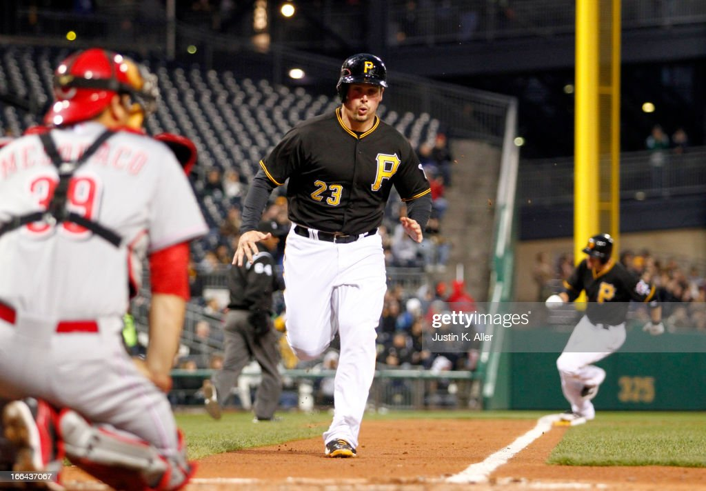 <a gi-track='captionPersonalityLinkClicked' href=/galleries/search?phrase=Travis+Snider&family=editorial&specificpeople=4959427 ng-click='$event.stopPropagation()'>Travis Snider</a> #23 of the Pittsburgh Pirates scores on a two-RBI single by Neil Walker (not pictured) in the second inning against the Cincinnati Reds during the game on April 12, 2013 at PNC Park in Pittsburgh, Pennsylvania.