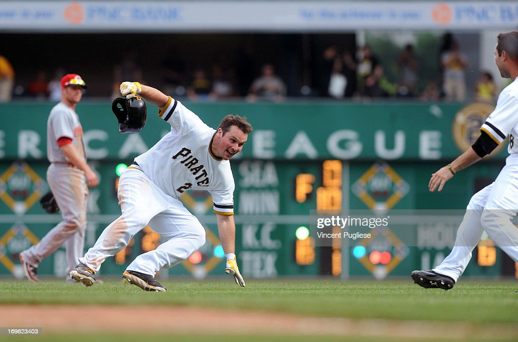 <a gi-track='captionPersonalityLinkClicked' href=/galleries/search?phrase=Travis+Snider&family=editorial&specificpeople=4959427 ng-click='$event.stopPropagation()'>Travis Snider</a> #23 of the Pittsburgh Pirates tries to avoid being mobbed by his teammates after driving in the winning run in the eleventh inning to defeat the the Cincinnati Reds 5-4 at PNC Park on June 2, 2013 in Pittsburgh, Pennsylvania.