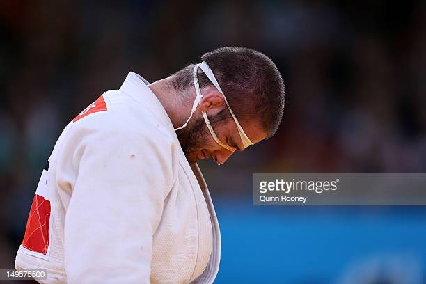 Travis Stevens of the United States reacts to losing to Ole Bischof of Germany in the Men's 81 kg Judo on Day 4 of the London 2012 Olympic Games at...