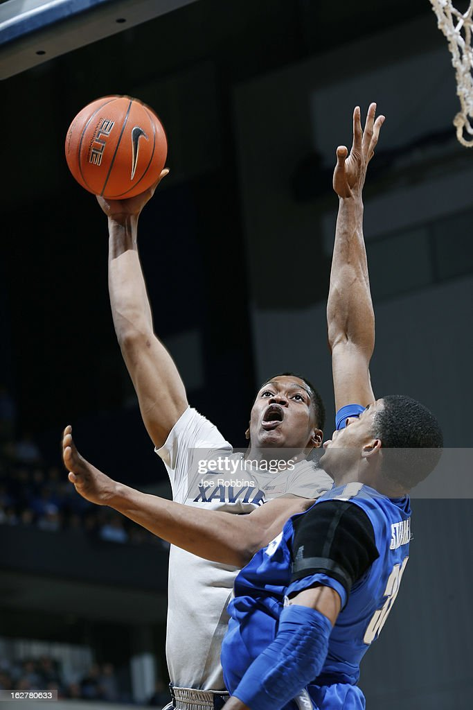 Travis Taylor #4 of the Xavier Musketeers goes to the basket against D.J. Stephens #30 of the Memphis Tigers during the game at Cintas Center on February 26, 2013 in Cincinnati, Ohio. Xavier defeated Memphis 64-62.