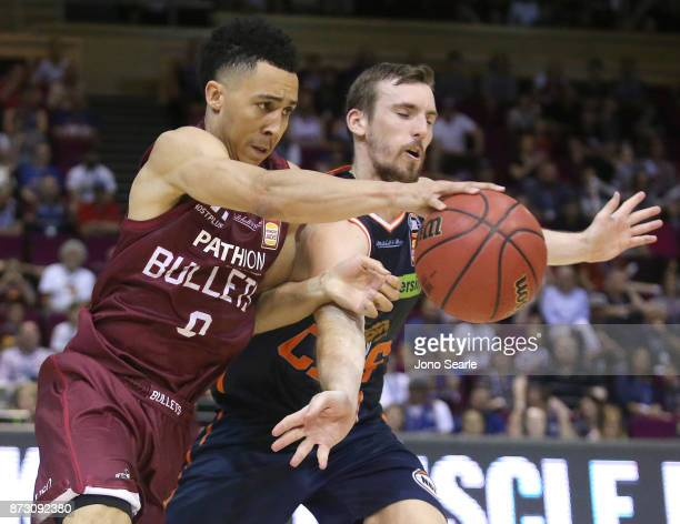 Travis Trice of Brisbane drives to the basket past Mitch McCarron of Cairns during the round six NBL match between the Brisbane Bullets and the...
