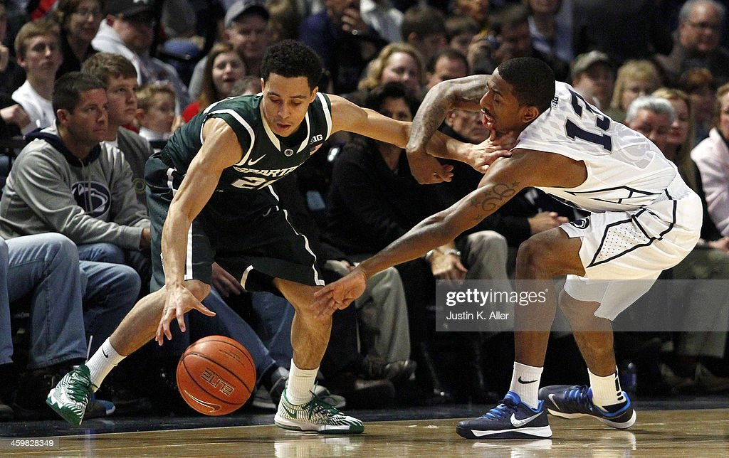 Travis Trice #20 of the Michigan State Spartans and Geno Thorpe #13 of the Penn State Nittany Lions battle for a loose ball at the Bryce Jordan Center on December 31, 2013 in State College, Pennsylvania.