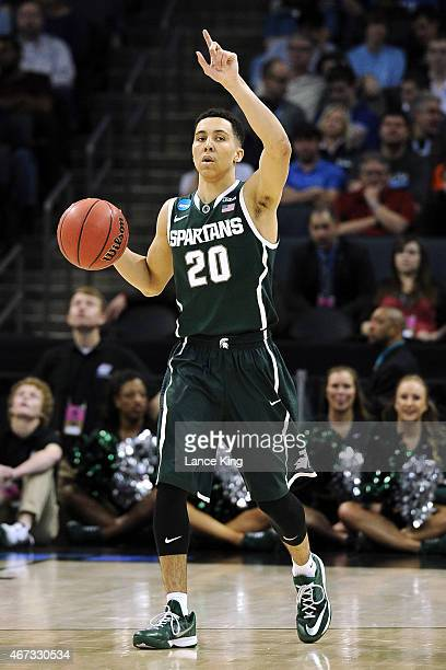 Travis Trice of the Michigan State Spartans calls a play against the Virginia Cavaliers during the third round of the 2015 NCAA Men's Basketball...