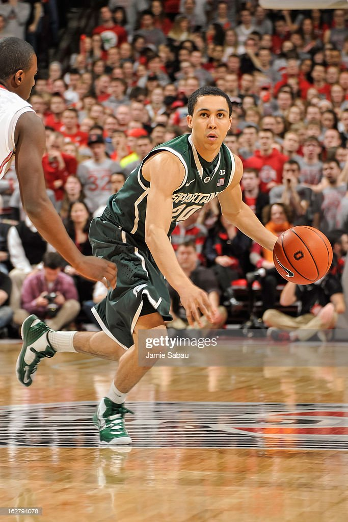 Travis Trice #20 of the Michigan State Spartans controls the ball against the Ohio State Buckeyes on February 24, 2013 at Value City Arena in Columbus, Ohio.