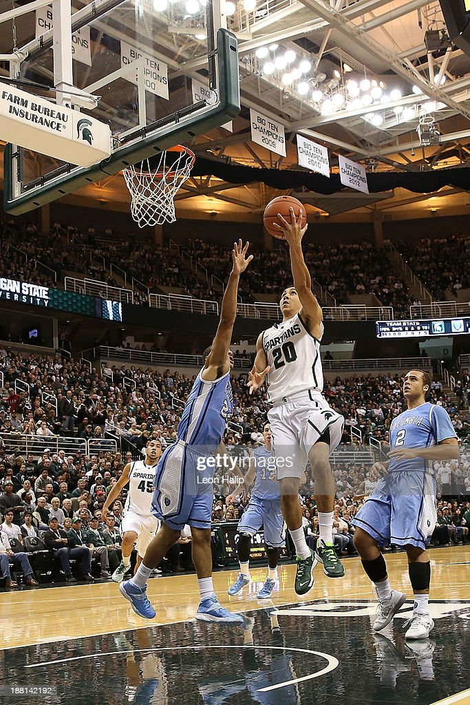 Travis Trice #20 of the Michigan State Spartans drives the ball to the basket during the second half of the game against the Columbia Lions at Breslin Center on November 15, 2013 in East Lansing, Michigan. Michigan State defeated Columbia 62-53.
