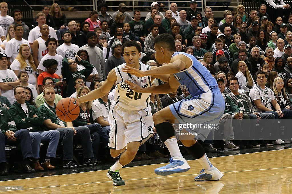 Travis Trice #20 of the Michigan State Spartans drives the ball to the basket as Maodo Lo #12 of the Columbia Lions defends during the second half of the game at Breslin Center on November 15, 2013 in East Lansing, Michigan. Michigan State defeated Columbia 62-53.