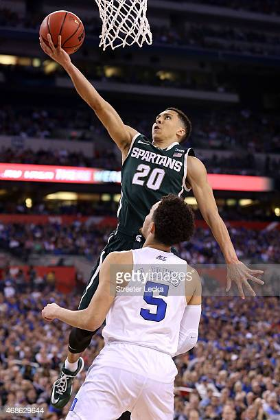 Travis Trice of the Michigan State Spartans drives to the basket against Tyus Jones of the Duke Blue Devils in the second half during the NCAA Men's...