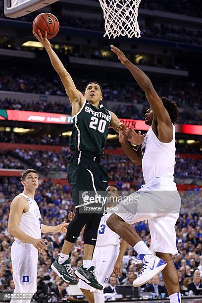 Travis Trice of the Michigan State Spartans drives to the basket against Justise Winslow of the Duke Blue Devils in the second half during the NCAA...