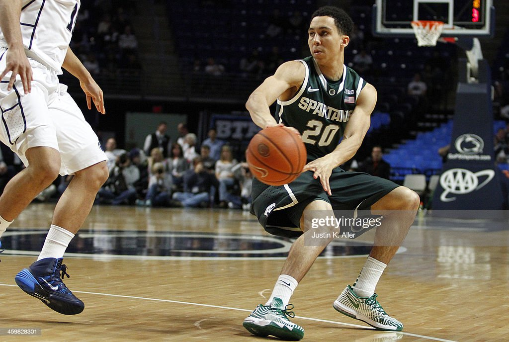 Travis Trice #20 of the Michigan State Spartans makes a pass against the Penn State Nittany Lions at the Bryce Jordan Center on December 31, 2013 in State College, Pennsylvania.