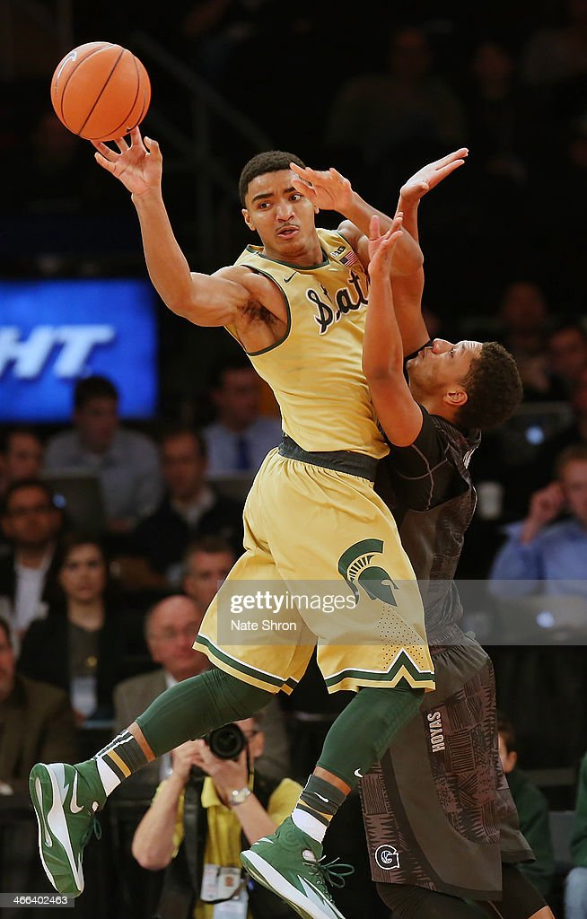 Travis Trice #20 of the Michigan State Spartans passes the ball against the Georgetown Hoyas during the game at Madison Square Garden on February 1, 2014 in New York City.
