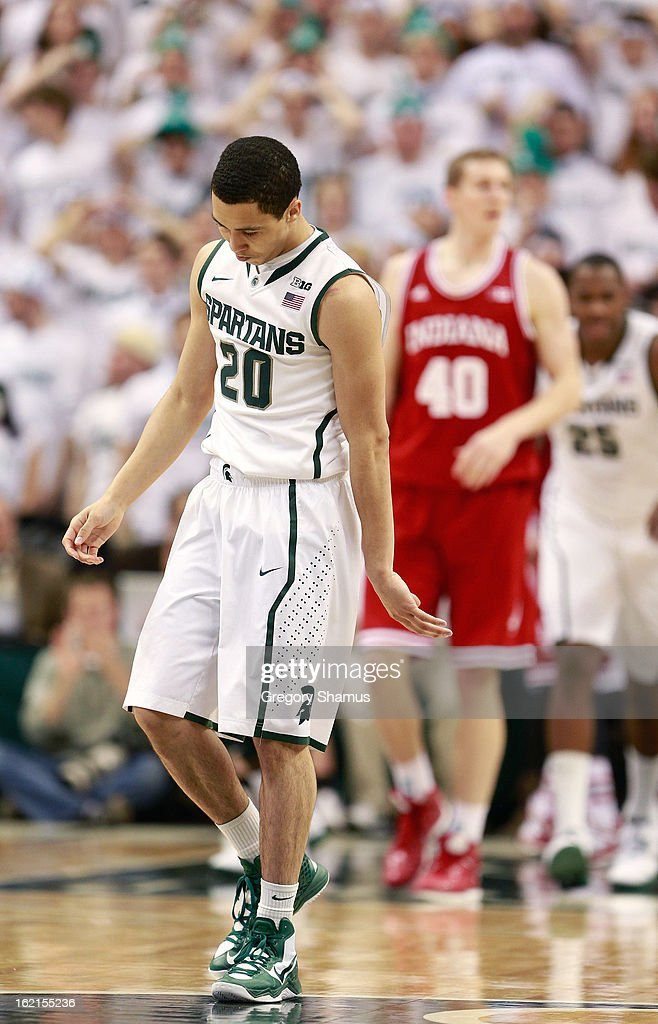 Travis Trice #20 of the Michigan State Spartans reacts after missing a first half shot while playing the Indiana Hoosiers at the Jack T. Breslin Student Events Center on February 19, 2013 in East Lansing, Michigan. Indiana won the game 72-68.