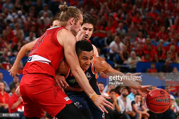 Travis Trice of the Taipans drives to the basket against Jesse Wagstaff of the Wildcatsduring the round 16 NBL match between the Perth Wildcats and...
