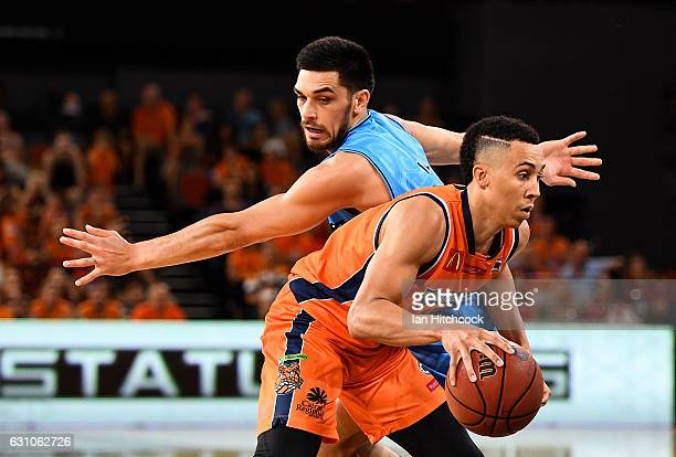 Travis Trice of the Taipans gets past Shea Lli of the Breakers during the round 14 NBL match between the Cairns Taipans and the New Zealand Breakers...