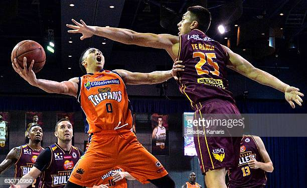 Travis Trice of the Taipans takes on the defence during the round 13 NBL match between Brisbane and Cairns on December 31 2016 in Brisbane Australia