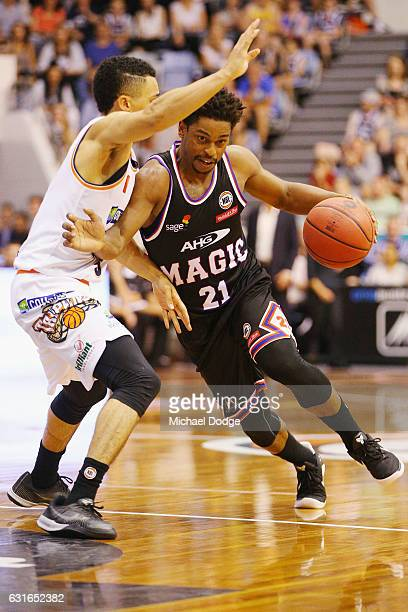 Travis Trice of the Taipans tries to stop Casper Ware of United driving hard to the basket during the round 15 NBL match between Melbourne United and...