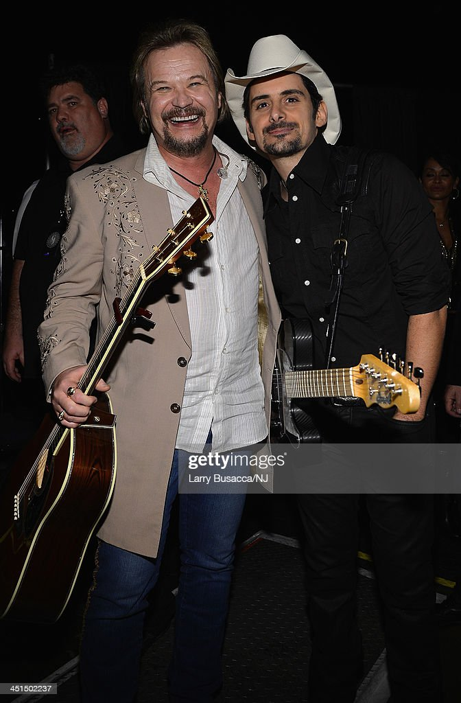 <a gi-track='captionPersonalityLinkClicked' href=/galleries/search?phrase=Travis+Tritt&family=editorial&specificpeople=215125 ng-click='$event.stopPropagation()'>Travis Tritt</a> and <a gi-track='captionPersonalityLinkClicked' href=/galleries/search?phrase=Brad+Paisley&family=editorial&specificpeople=206616 ng-click='$event.stopPropagation()'>Brad Paisley</a> attend Playin' Possum! The Final No Show Tribute To George Jones at Bridgestone Arena on November 22, 2013 in Nashville, Tennessee.