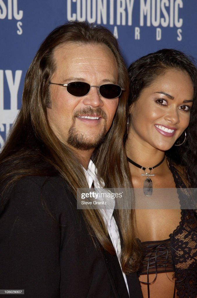 Travis Tritt and guest during The 37th Annual Academy of Country Music Awards Arrivals at Universal Amphitheater in Universal City California United...