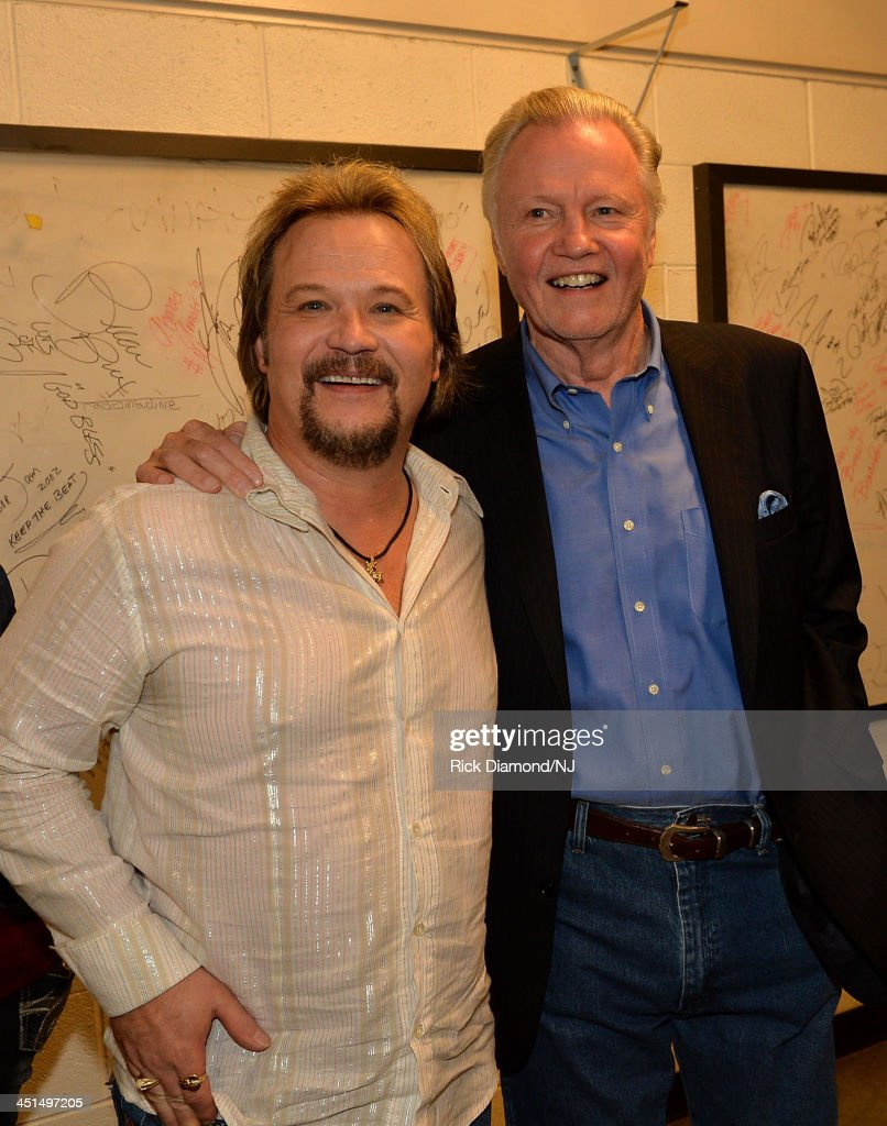 <a gi-track='captionPersonalityLinkClicked' href=/galleries/search?phrase=Travis+Tritt&family=editorial&specificpeople=215125 ng-click='$event.stopPropagation()'>Travis Tritt</a> and <a gi-track='captionPersonalityLinkClicked' href=/galleries/search?phrase=Jon+Voight&family=editorial&specificpeople=202872 ng-click='$event.stopPropagation()'>Jon Voight</a> attend Playin' Possum! The Final No Show Tribute To George Jones at Bridgestone Arena on November 22, 2013 in Nashville, Tennessee.