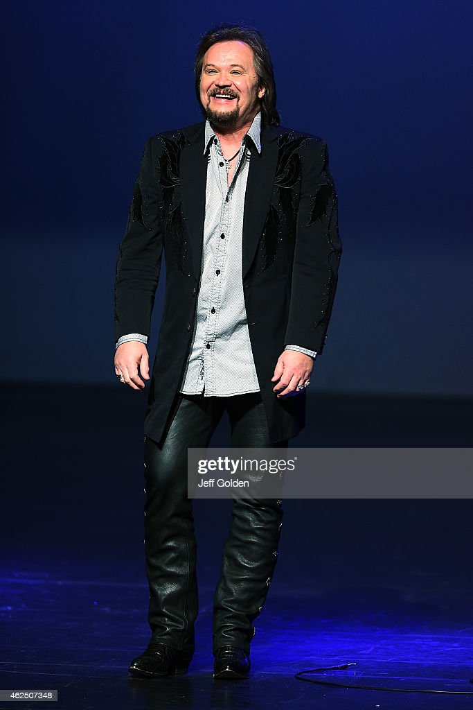Travis Tritt greets the audience as he takes the stage to perform on his 'An Acoustic Evening With Travis Tritt' Tour at Fred Kavli Theatre on...