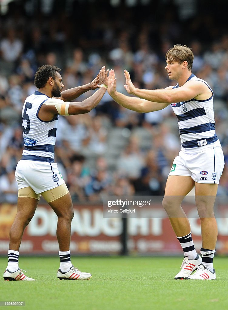Travis Varcoe (L) and Tom Hawkins of the Cats celebrate a goal during the round two AFL match between the Geelong Cats and the North Melbourne Kangaroos at Etihad Stadium on April 7, 2013 in Melbourne, Australia.