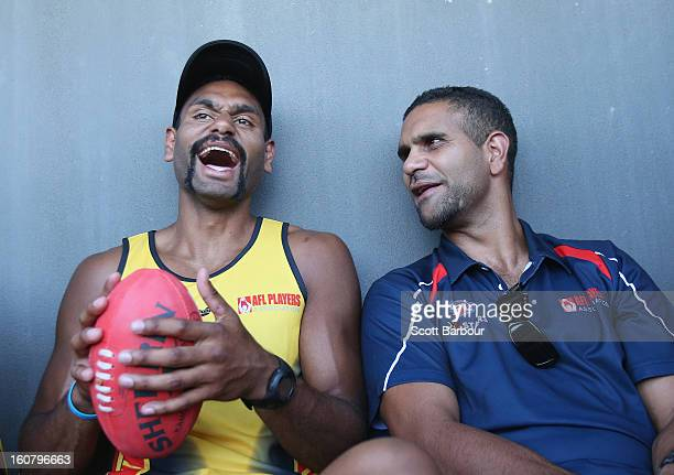 Travis Varcoe of the All Stars laughs with All Stars coach Michael O'Loughlin during a press conference ahead of the AFL exhibition match between the...