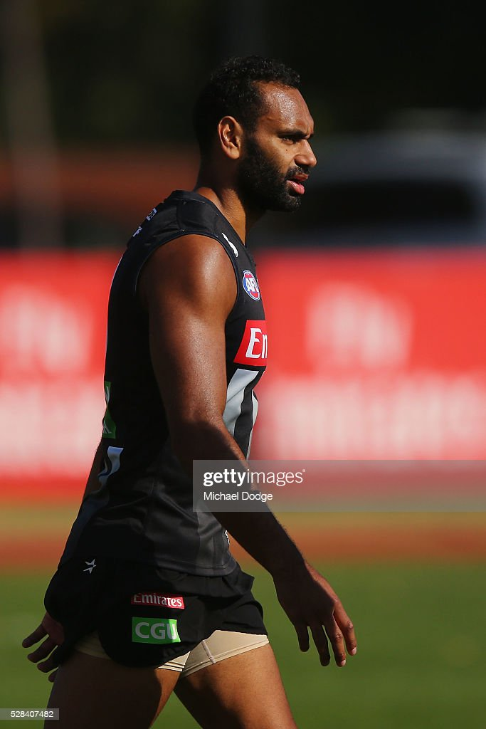 Travis Varcoe of the Magpies appears from over the fence bear the end of a Collingwood Magpies AFL training session on May 5, 2016 in Melbourne, Australia.