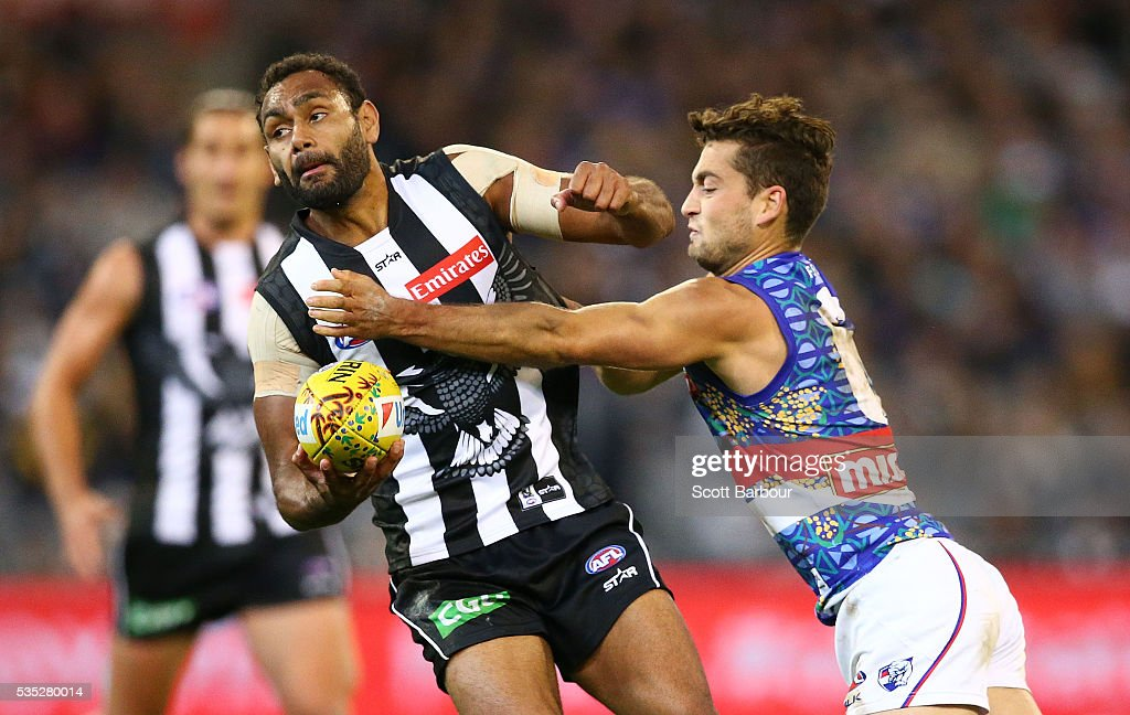 Travis Varcoe of the Magpies is tackled during the round 10 AFL match between the Collingwood Magpies and the Western Bulldogs at Melbourne Cricket Ground on May 29, 2016 in Melbourne, Australia.