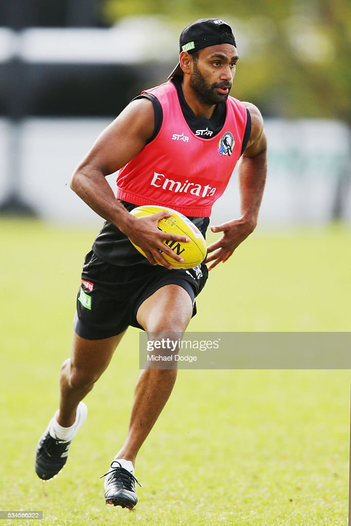 Travis Varcoe of the Magpies runs with the ball during a Collingwood Magpies AFL training session on May 27, 2016 in Melbourne, Australia.