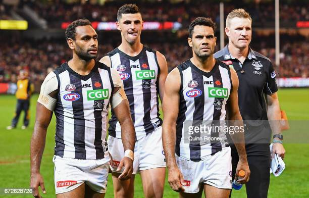 Travis Varcoe Scott Pendlebury Daniel Wells and Nathan Buckley of the Magpies look dejected after losing the round five AFL match between the...
