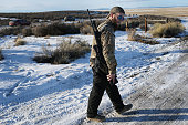 Travis walks with his weapon as he joins others at the Malheur National Wildlife Refuge on January 15 2016 near Burns Oregon Travis didn't provide...