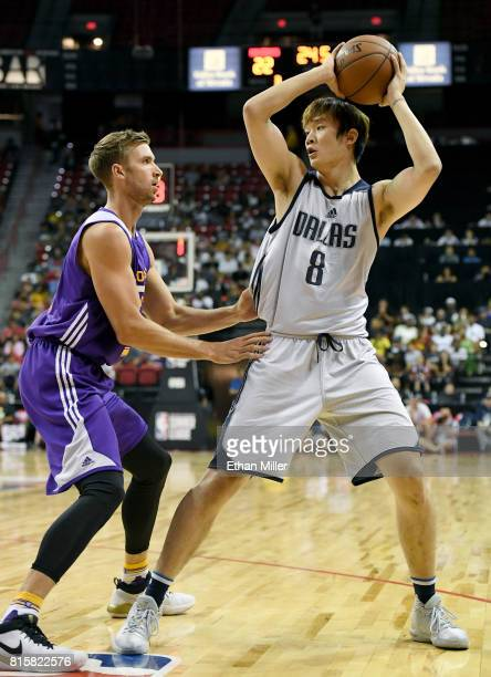 Travis Wear of the Los Angeles Lakers guards Ding Yanyuhang of the Dallas Mavericks during a semifinal game of the 2017 Summer League at the Thomas...