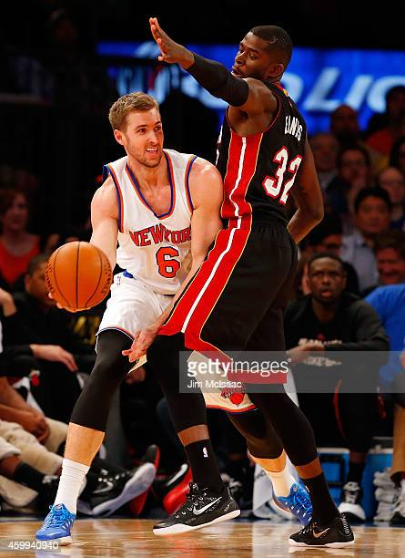 Travis Wear of the New York Knicks in action against James Ennis of the Miami Heat at Madison Square Garden on November 30 2014 in New York City The...