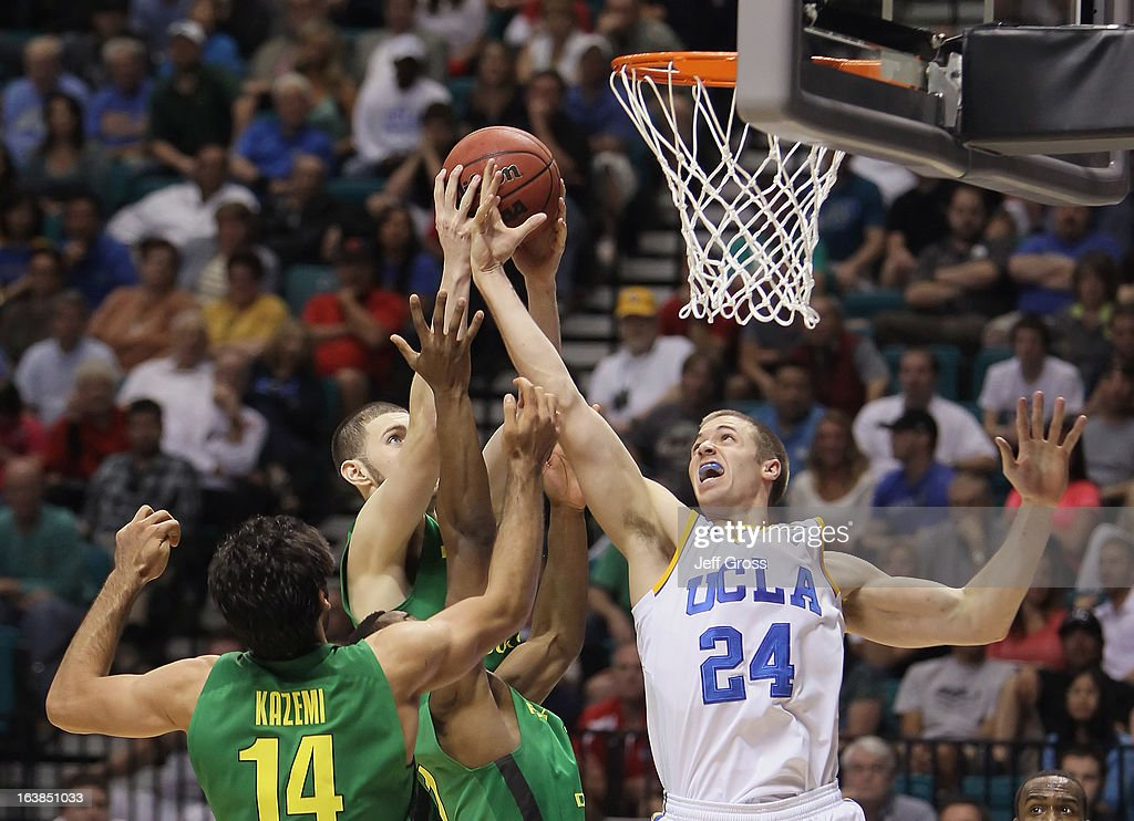 Travis Wear #24 of the UCLA Bruins and Arsalan Kazemi #14 of the Oregon Ducks fight for a rebound in the second half during the Pac-12 Championship game at the MGM Grand Garden Arena on March 16, 2013 in Las Vegas, Nevada. Oregon defeated UCLA