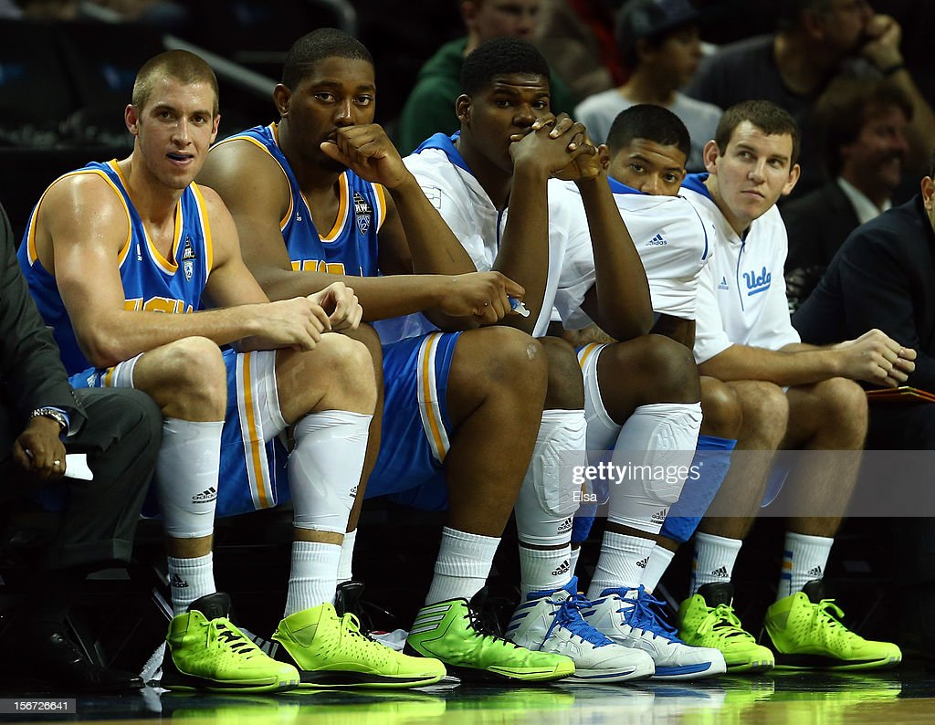 Travis Wear #24 of the UCLA Bruins and the rest of the bench watches the end of the game against the Georgetown Hoyas during the Legends Classic on November 19, 2012 at the Barclays Center in the Brooklyn borough of New York City. The Georgetown Hoyas defeated the UCLA Bruins 78-70.