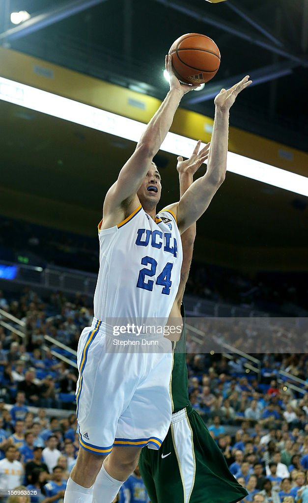Travis Wear #24 of the UCLA Bruins shoots against the Cal Poly Mustangs at Pauley Pavilion on November 25, 2012 in Los Angeles, California. Cal Poly won 70-68.
