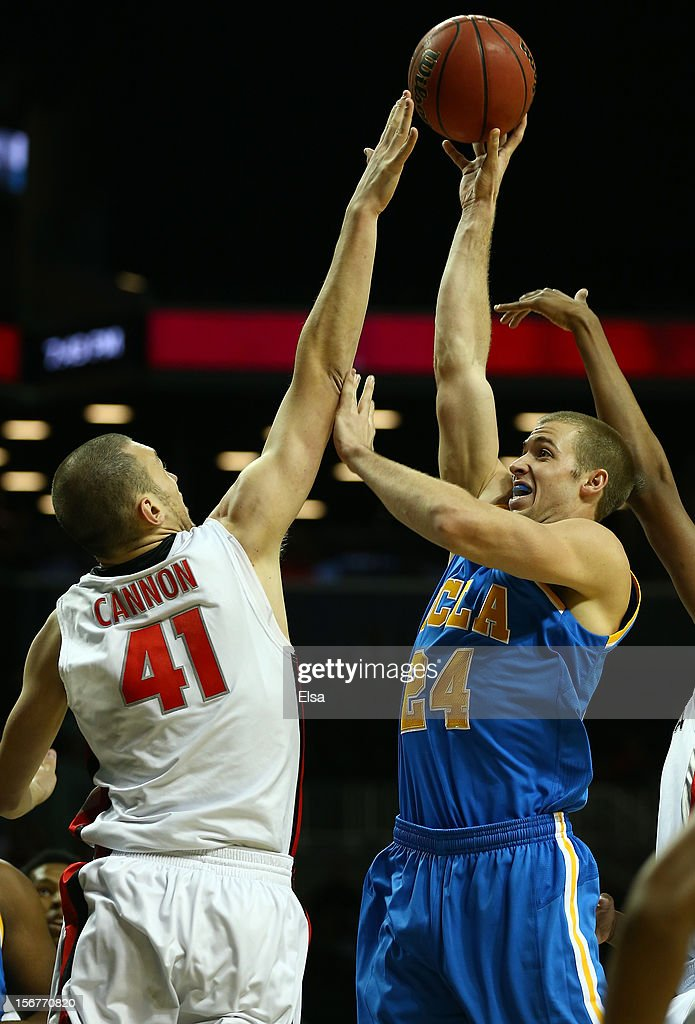 Travis Wear #24 of the UCLA Bruins takes a shot as John Cannon #41 of the Georgia Bulldogs defends during the Legends Classic on November 20,2012 at the Barclays Center in the Brooklyn borough of New York City.