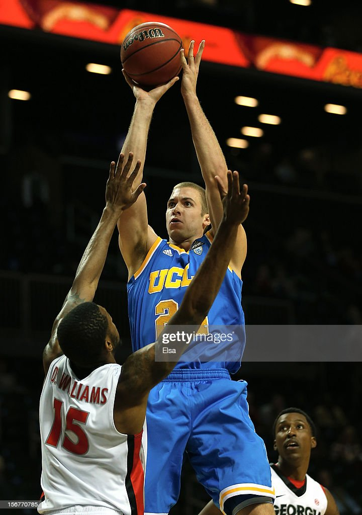 Travis Wear #24 of the UCLA Bruins takes a shot in the first half as Donte' Williams #15 of the Georgia Bulldogs defends during the Legends Classic on November 20,2012 at the Barclays Center in the Brooklyn borough of New York City.