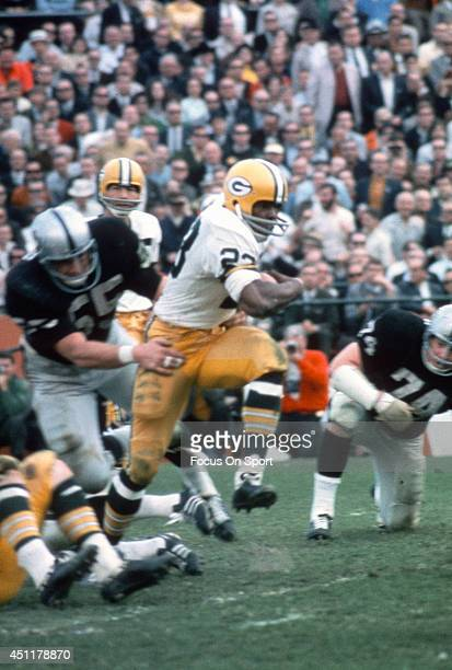 Travis Williams of the Green Bay Packers breaks the tackle of Dan Conners of the Oakland Raiders during Super Bowl II January 14 1968 at the Orange...