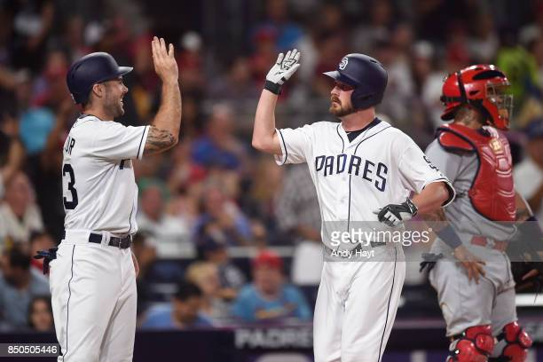 Travis Wood is congratulated by Matt Szczur of the San Diego Padres after hitting a home run during the game against the St Louis Cardinals at Petco...