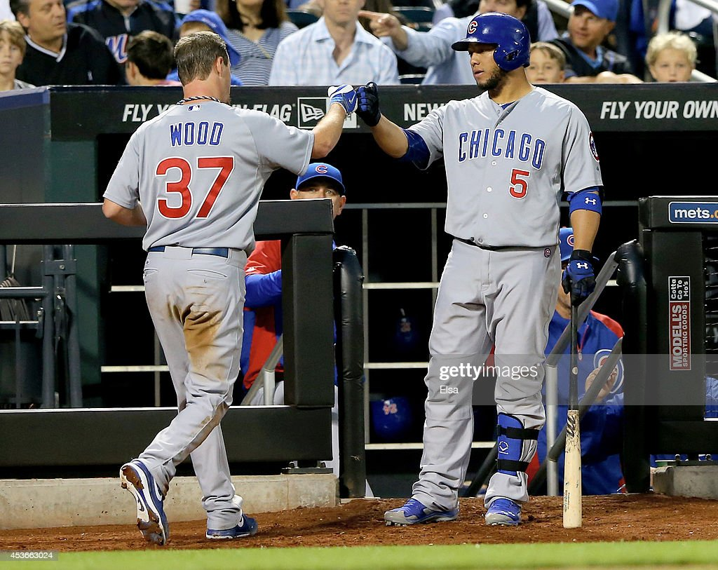 <a gi-track='captionPersonalityLinkClicked' href=/galleries/search?phrase=Travis+Wood&family=editorial&specificpeople=805314 ng-click='$event.stopPropagation()'>Travis Wood</a> #37 is congratulated by teammate <a gi-track='captionPersonalityLinkClicked' href=/galleries/search?phrase=Welington+Castillo&family=editorial&specificpeople=4959193 ng-click='$event.stopPropagation()'>Welington Castillo</a> #5 of the Chicago Cubs after Wood scored in the third inning against the New York Mets on August 15, 2014 at Citi Field in the Flushing neighborhood of the Queens borough of New York City.