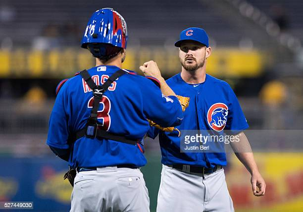 Travis Wood is greeted by David Ross of the Chicago Cubs after getting the final out in the Chicago Cubs 72 win over the Pittsburgh Pirates at PNC...
