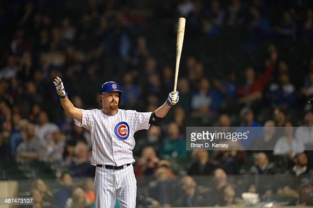 Travis Wood of the Chicago Cubs bats during the sixth inning against the Arizona Diamondbacks at Wrigley Field on April 21 2014 in Chicago Illinois...