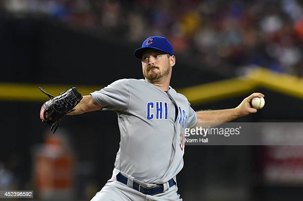 Travis Wood of the Chicago Cubs delivers a first inning pitch against the Arizona Diamondbacks at Chase Field on July 19 2014 in Phoenix Arizona