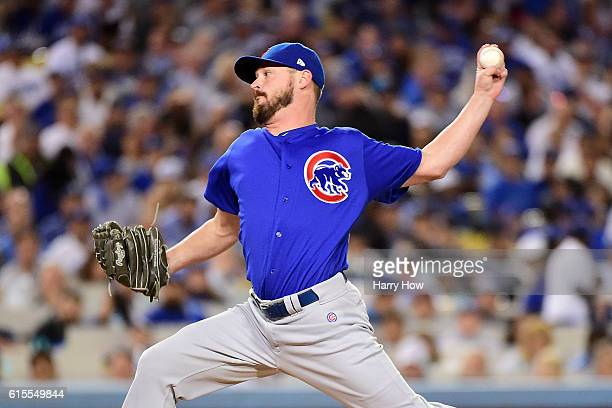 Travis Wood of the Chicago Cubs delivers a pitch against the Los Angeles Dodgers in the sixth inning of game three of the National League...