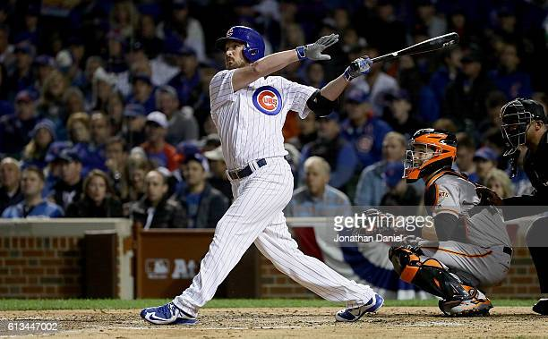 Travis Wood of the Chicago Cubs hits a home run in the fourth inning against the San Francisco Giants at Wrigley Field on October 8 2016 in Chicago...