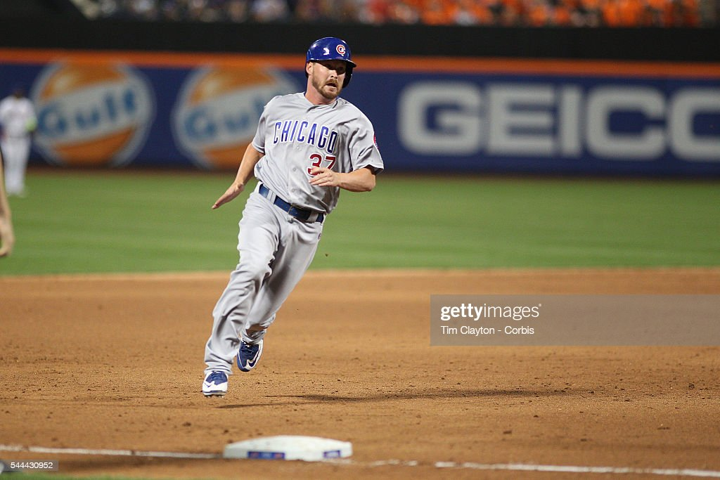 <a gi-track='captionPersonalityLinkClicked' href=/galleries/search?phrase=Travis+Wood&family=editorial&specificpeople=805314 ng-click='$event.stopPropagation()'>Travis Wood</a> #37 of the Chicago Cubs is held up at third base in the ninth inning during the Chicago Cubs Vs New York Mets regular season MLB game at Citi Field on June 30, 2016 in New York City.