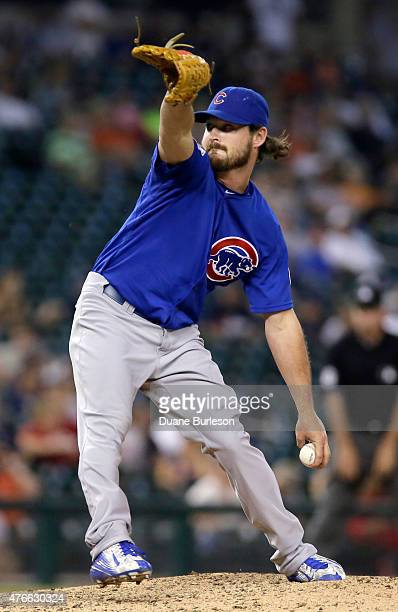 Travis Wood of the Chicago Cubs pitches against the Detroit Tigers during the ninth inning at Comerica Park on June 10 2015 in Detroit Michigan The...